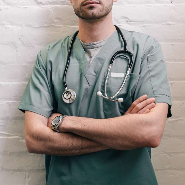 male doctor standing with folded arms