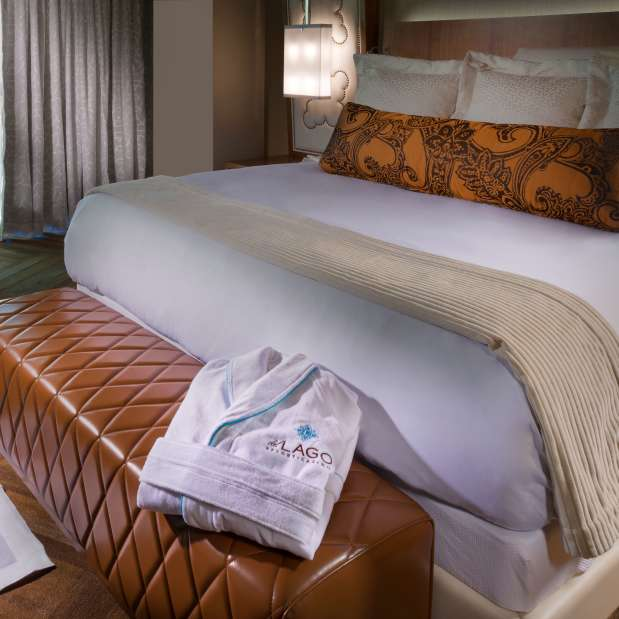 del Lago Guest suite with robe and slippers laid out by bed