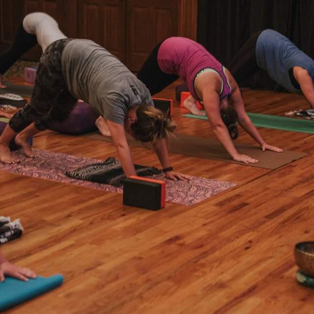 Yoga instructor leading class