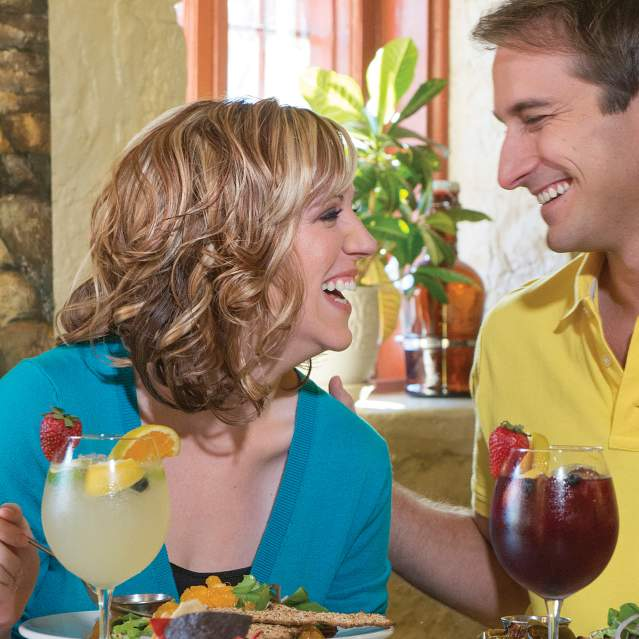 Couple laughing at lunch table