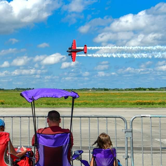 Family watching plane aerobatics