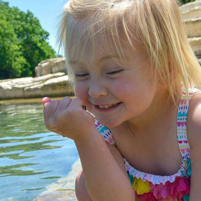 Little girl excited to play in the river