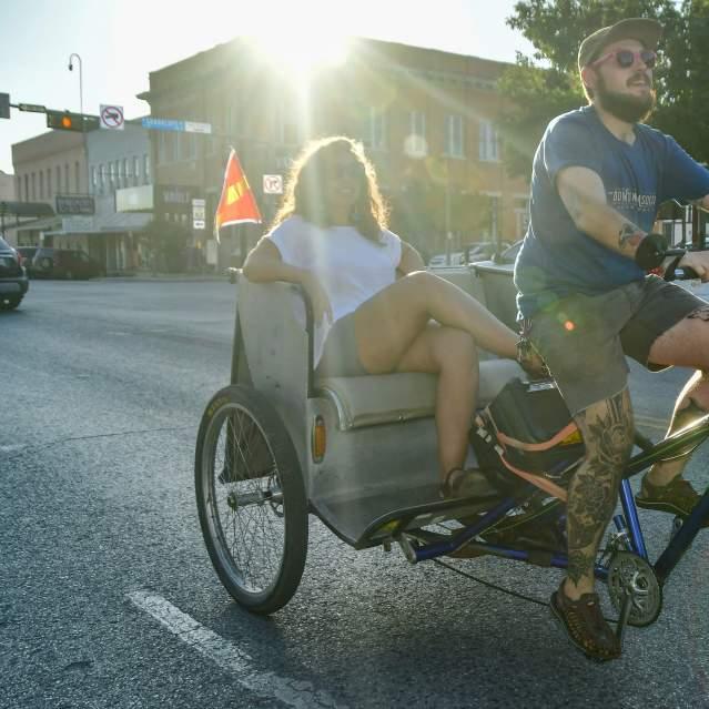 Pedicab taking woman around downtown