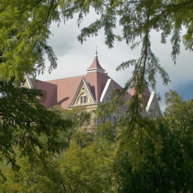 View of Old Main through the trees