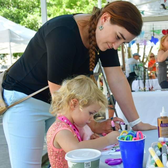 Little girl doing art at downtown event