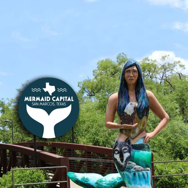 Before Us Mermaid March statue with the Mermaid Capital of Texas graphic beside it.