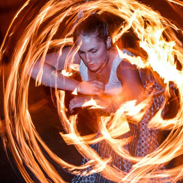 Woman spinning fire