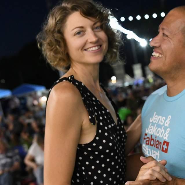 Couple dancing at ourdoor concert