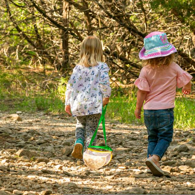 Two little girls walking down trails