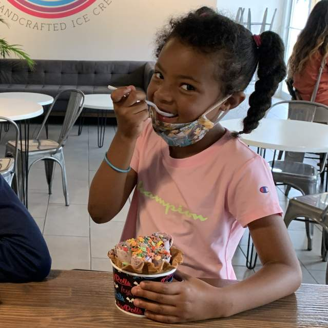 Two kids enjoying ice cream