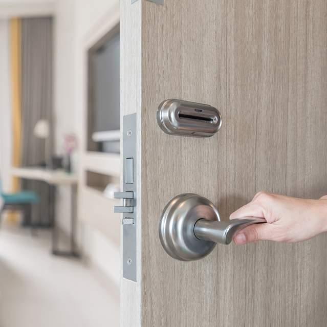 Door opening to hotel room