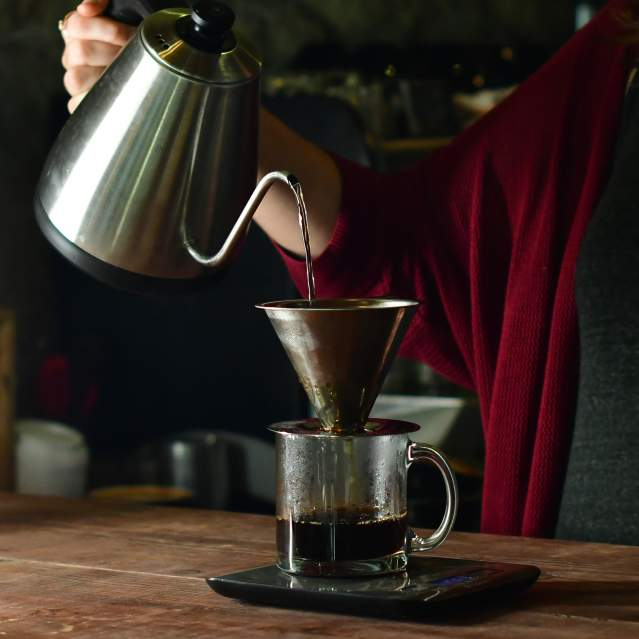Barista making coffee pour-over