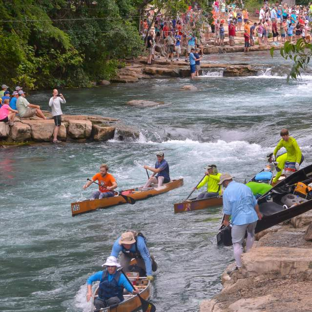 Texas Water Safari kayak racers portage at Rio Vista Falls