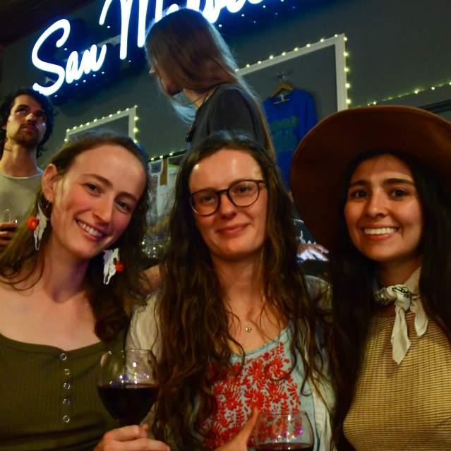 Three women at live music event