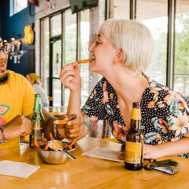 Couple sharing fries at downtown restaurant
