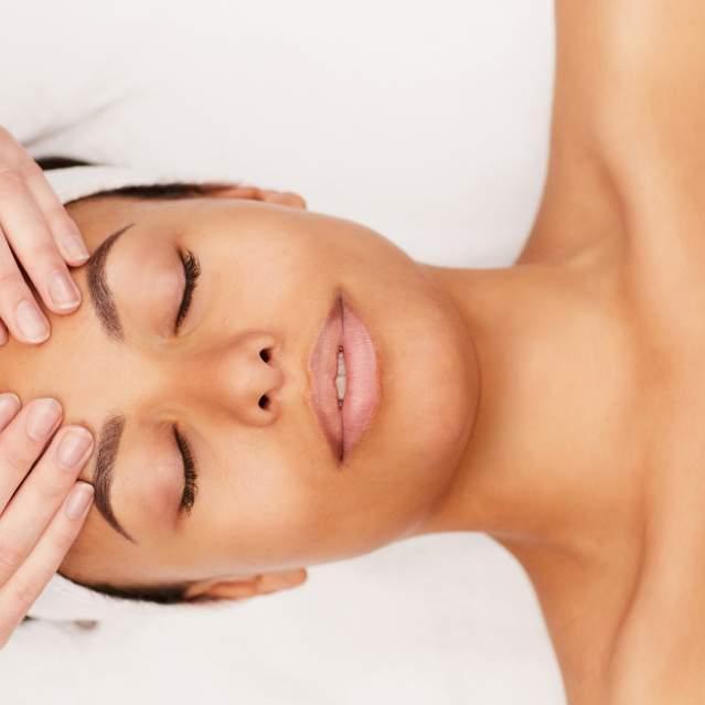 Woman getting facial at spa