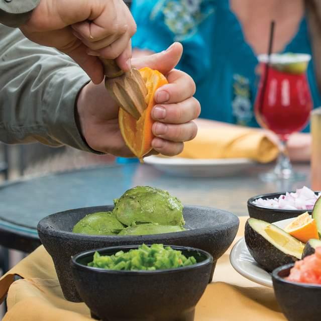Server making tableside guacamole