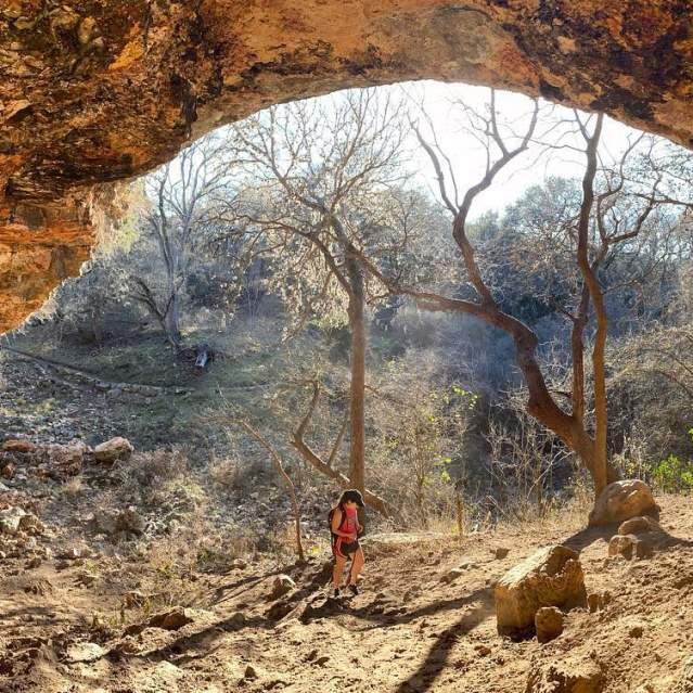 Hiker exploring Upper Purgatory Creek Natural Area