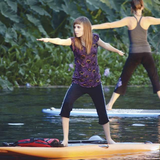 Yoga on stand-up paddle boards