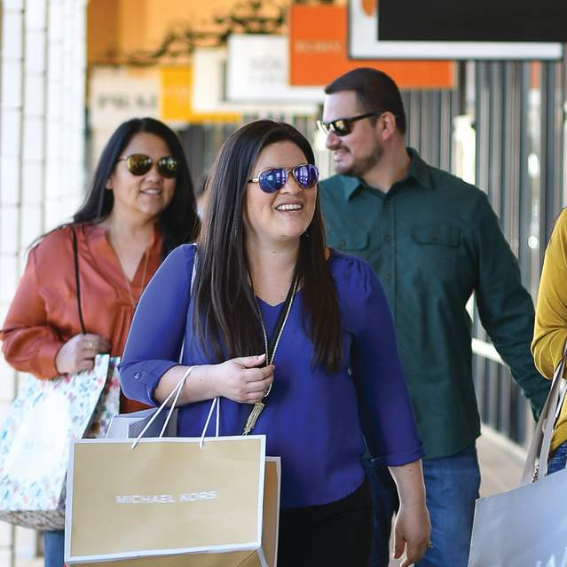Four shoppers with bags