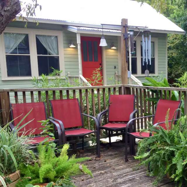 Small home with lush deck