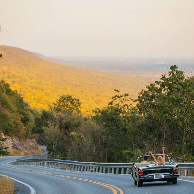 Couple driving in a convertible car along Waggoner's Gap