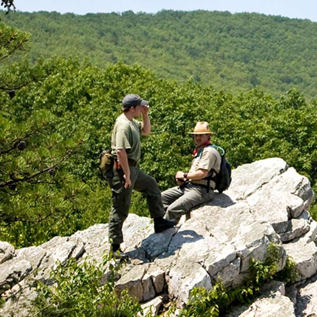 Two men resting on a rock at Pine Grove Furnace State Park