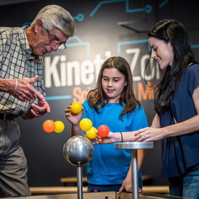 Orlando Science Center's Mini Maker Faire dad and girls