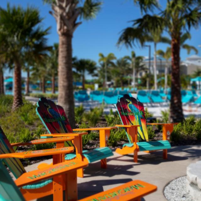 Parrot-themed adirondack chairs around a firepit at Margaritaville Resort Orlando hotel. Photo by CJ Walker.