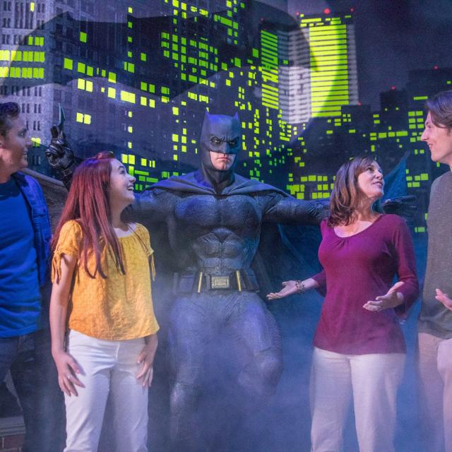 Group poses with Batman at Madame Tussauds