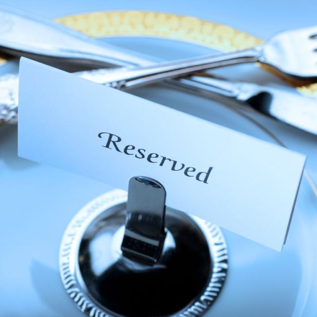 Reserved seating for a formal dinner.