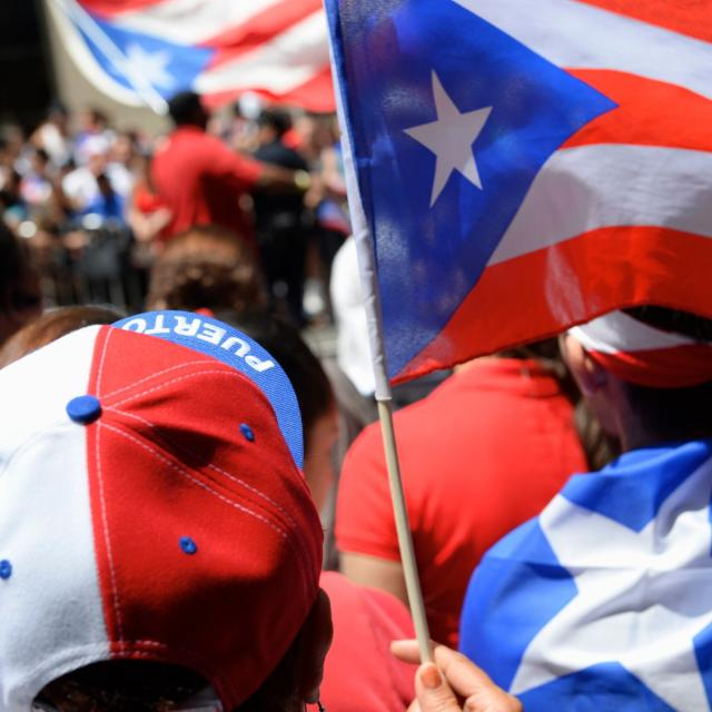 Puerto Rican pride comes in red white and blue at a PR day parade.
