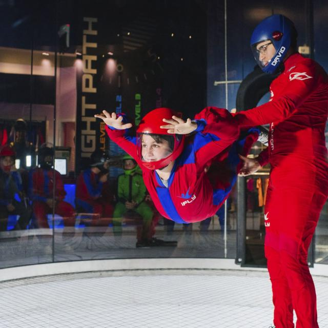 IFLY Orlando Indoor Skydiving child flyer with trainer