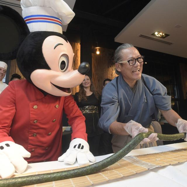 Chef Masaharu Morimoto and Mickey Mouse at the Grand Opening of Morimoto Asia restaurant in Disney Springs