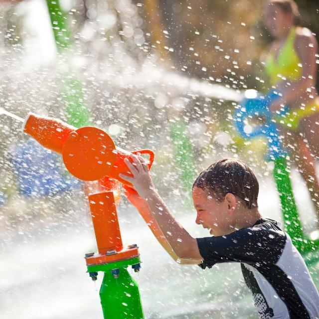 Renaissance Orlando At SeaWorld children shooting water cannon in Aqua Zone
