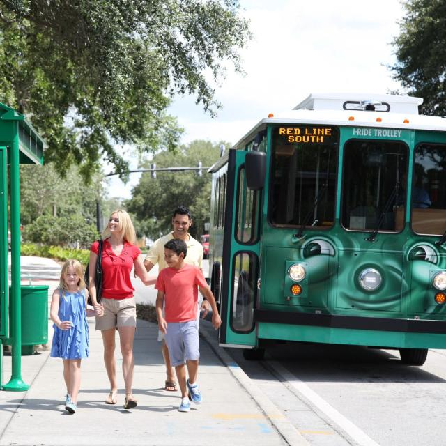 I-Ride Trolley Services family at bus stop