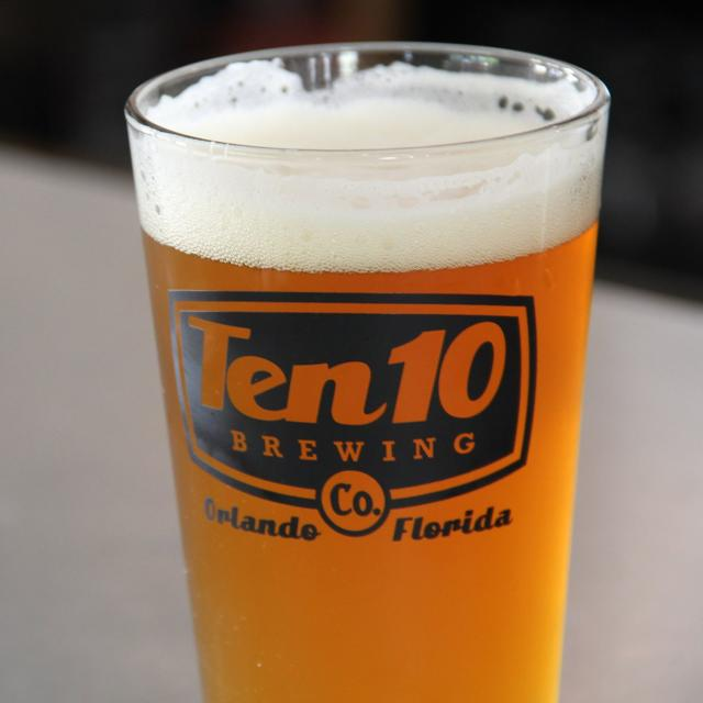 A pint glass filled with beer from Ten10 Brewing Company in Orlando, Florida.