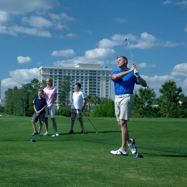A family playing golf at the Waldorf Astoria Golf Club