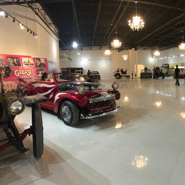 An array of classic cars on display at Dezerland Action Park auto museum.