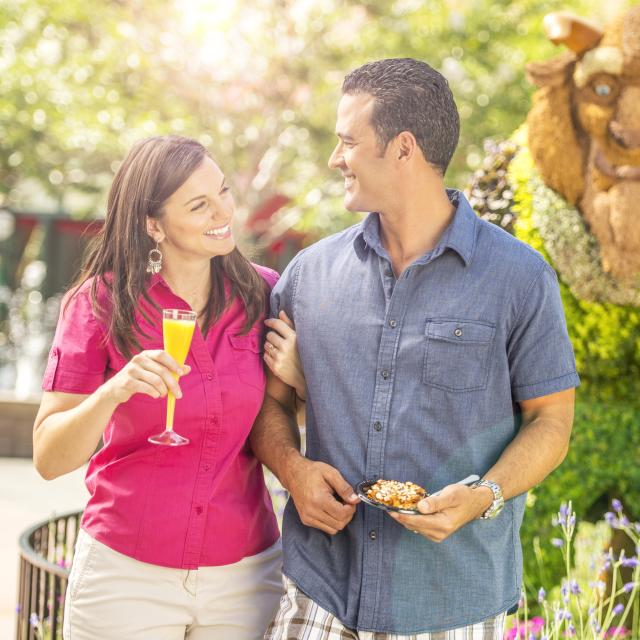 A couple strolling through Epcot Flower and Garden Show, at Walt Disney World Resort.