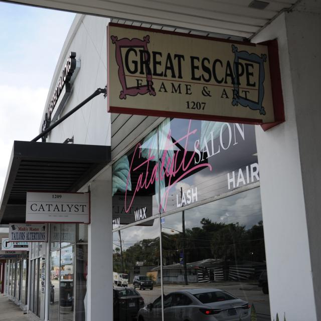 Great Escape Frame & Art and Catalyst Salon shops in Mills 50, in Orlando.