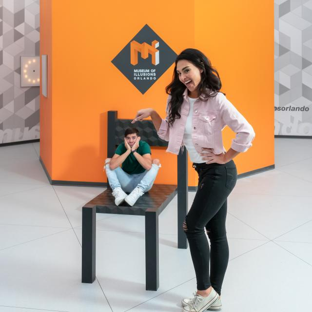 museum of illusions beuchet chair boy girl