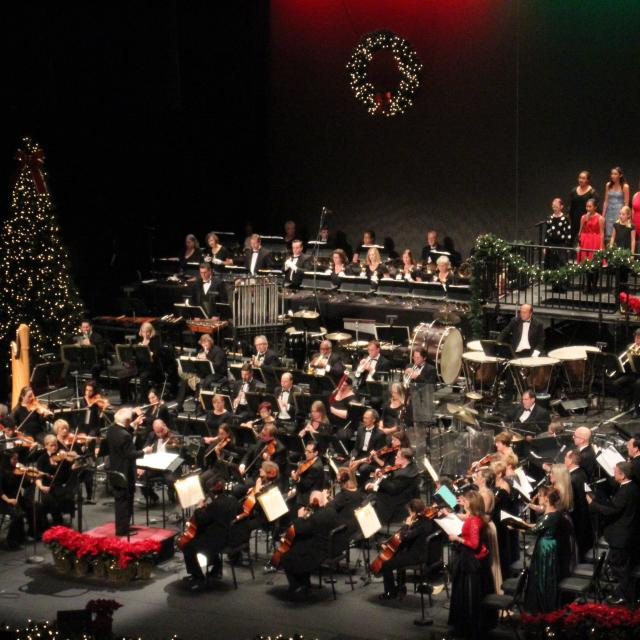 Orlando Philharmonic Orchestra performing a holiday concert.