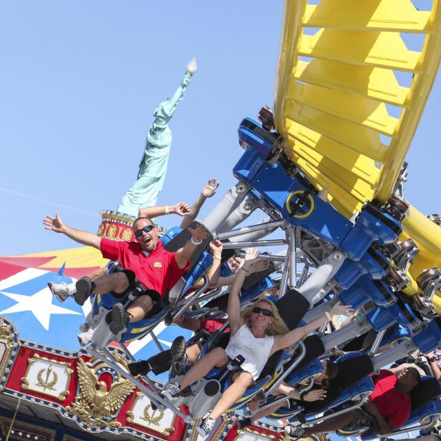 Guests riding the Freedom Flyer ride at Fun Spot America in Orlando.