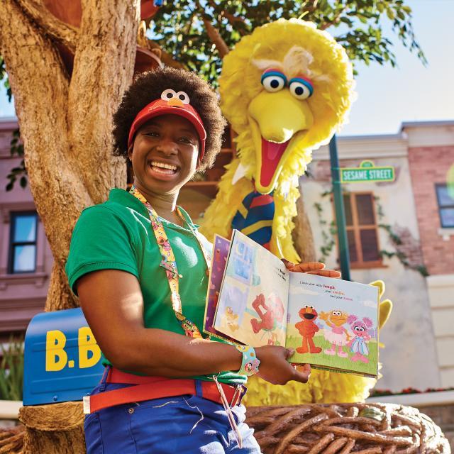 Big Bird reading a book in Sesame Street Land at SeaWorld Orlando