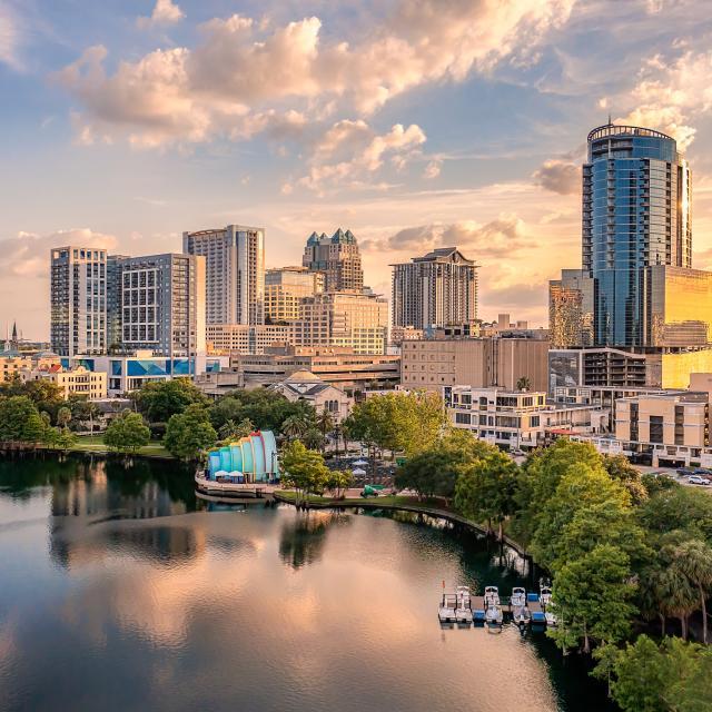 Aerial photo of downtown Orlando and Lake Eola at dusk