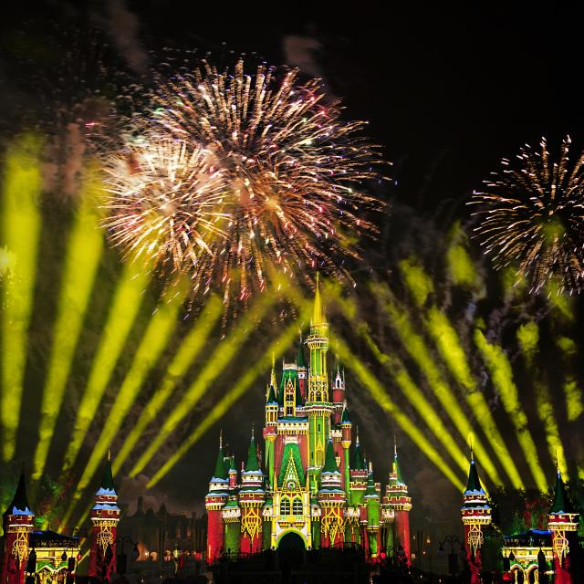 Cinderella Castle lit up with holiday lights and fireworks at Magic Kingdom Park for Disney's Very Merriest After Hours at Walt Disney World