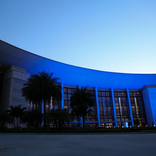 Orange County Convention Center lit up in blue