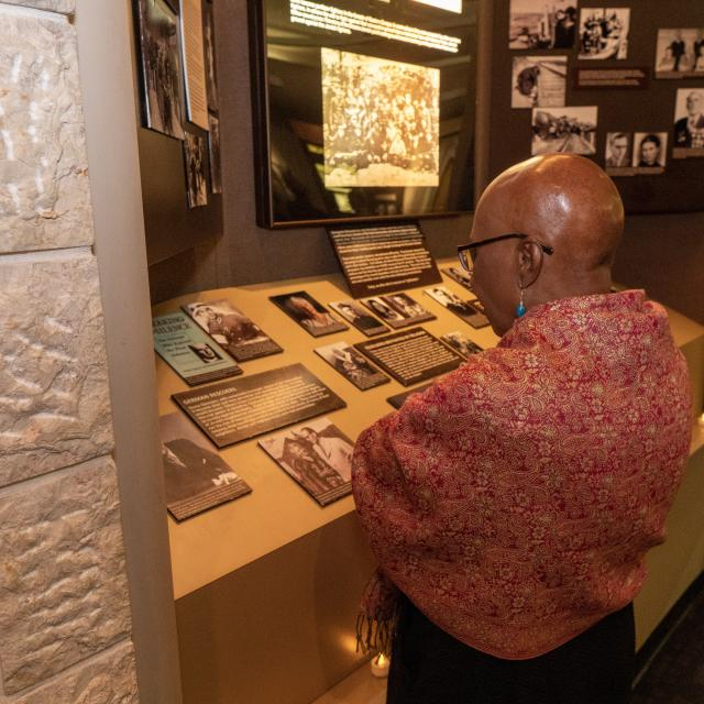 A visitor studies an exhibit at the Holocaust Memorial Resource and Education Center of Florida