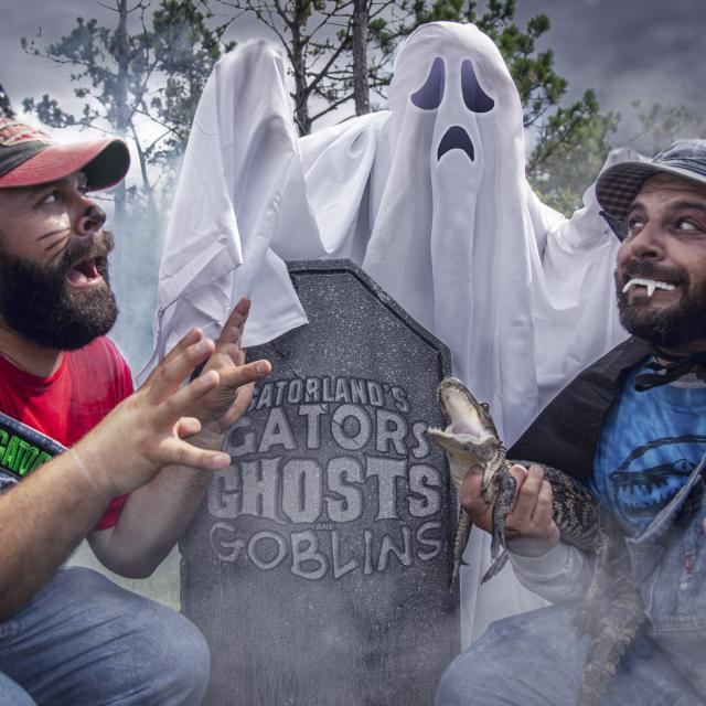 Bubba and Cooter in a graveyard with a Ghost at Gatorland's Gators, Ghosts and Goblins Halloween event